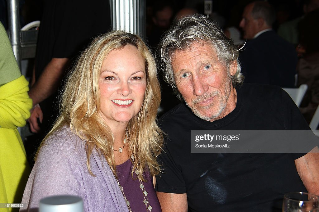 Patty Hearst Shaw and Roger Waters attend the 22nd Annual Summer Benefit and Auction 'Circus of Stillness' at The Watermill Center on July 25, 2015 in Water Mill, New York.