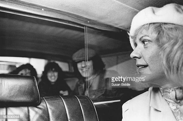 OCT 28 1983 OCT 30 1983 Patty Hipp in her limo as she leaves Fairmont to take AC/DC group to airport Simon Wright drums Angus Young guitar and Brian...