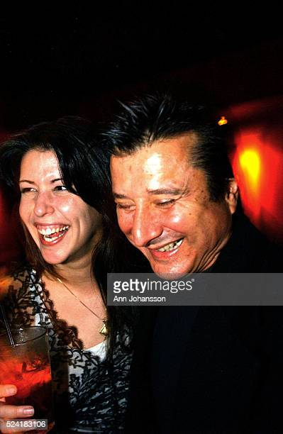 Patty Jenkins screenwriter and director of the movie 'Monster' laughs together with Journey band member Steve Perry in the bar The Sapphire 'Monster'...