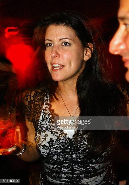 Patty Jenkins screenwriter and director of the movie 'Monster' speaks in the bar The Sapphire Steve Perry of the band Journey listens to her...