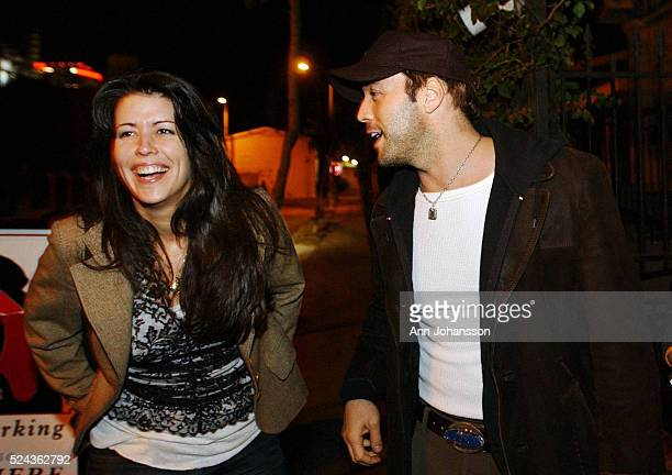 Patty Jenkins screenwriter and director of the movie 'Monster' speaks with friend and actor Jeremy Piven outside the restaurant Cafe des Artistes...