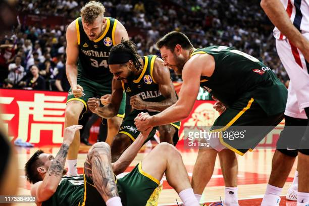 Patty Mills, Jock Landale and Matthew Dellavedova of Australia react during 2nd round Group L match between Australia and France of 2019 FIBA World...