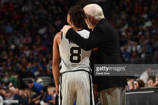 Patty Mills and Head Coach Gregg Popovich of the San Antonio Spurs look on during the game against the Philadelphia 76ers on January 23 2019 at the...