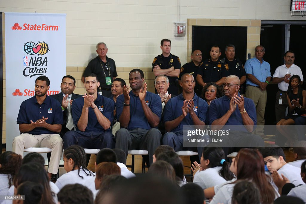 Patty Mills, Danny Green, Hall of Famer David Robinson, Sean Elliott and Hall of Famer George Gervin of the San Antonio Spurs participate at the 2013 NBA Cares Legacy Project as part of the 2013 NBA Finals on June 7, 2013 at the Wheatley Middle School in San Antonio, Texas.