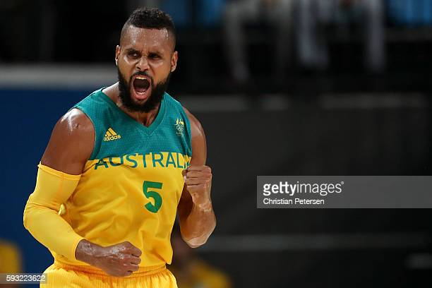 Patty Mills of Australia celebrates a basket during the Men's Basketball Bronze medal game between Australia and Spain on Day 16 of the Rio 2016...