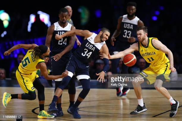Patty Mills of the Boomers and Nicholas Kay of the Boomers steal the ball from Jayson Tatum of the USA during game two of the International...