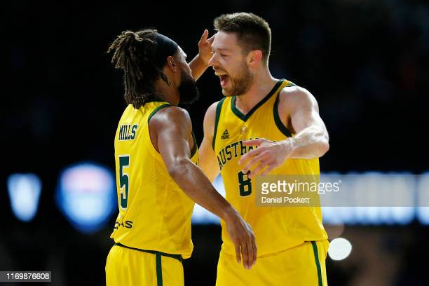 Patty Mills of the Boomers celebrates with Matthew Dellavedova of the Boomers during game two of the International Basketball series between the...
