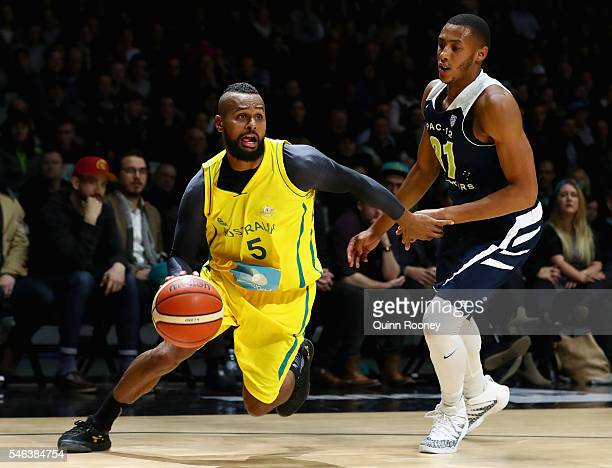 Patty Mills of the Boomers dribbles the ball past Stephen Domingo of the AllStars during the match between the Australian Boomers and the Pac12...