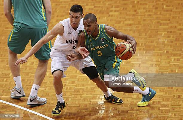 Patty Mills of the Boomers drives to the basket during the Men's FIBA Oceania Championship match between the Australian Boomers and the New Zealand...