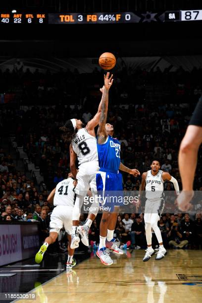 Patty Mills of the San Antonio Spurs and Lou Williams of the LA Clippers fight for the ball on November 29 2019 at the ATT Center in San Antonio...