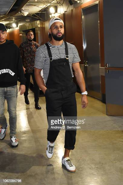 Patty Mills of the San Antonio Spurs arrives before a game against the LA Clippers at STAPLES Center on November 15 2018 in Los Angeles California...