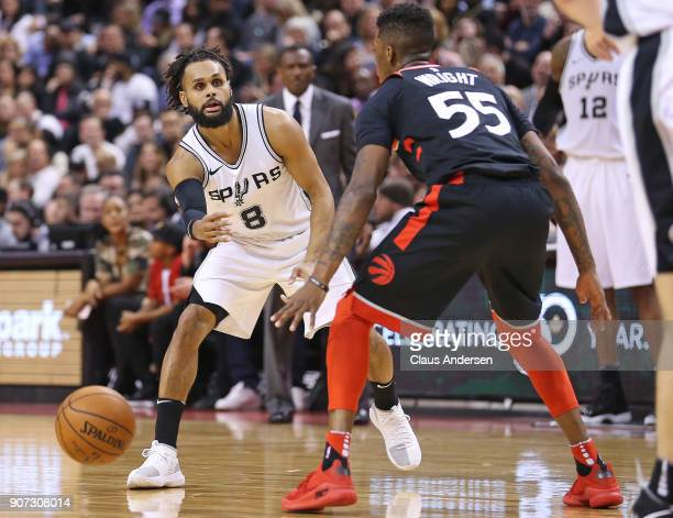 Patty Mills of the San Antonio Spurs bounces a pass past Delon Wright of the Toronto Raptors in an NBA game at the Air Canada Centre on January 19...