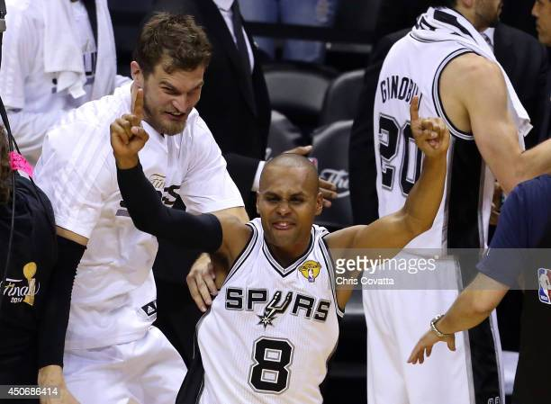 Patty Mills of the San Antonio Spurs celebrates after defeating the Miami Heat in Game Five of the 2014 NBA Finals at the ATT Center on June 15 2014...
