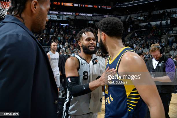 Patty Mills of the San Antonio Spurs congratulates Cory Joseph of the Indiana Pacers on a game well played on January 21 2018 at the ATT Center in...