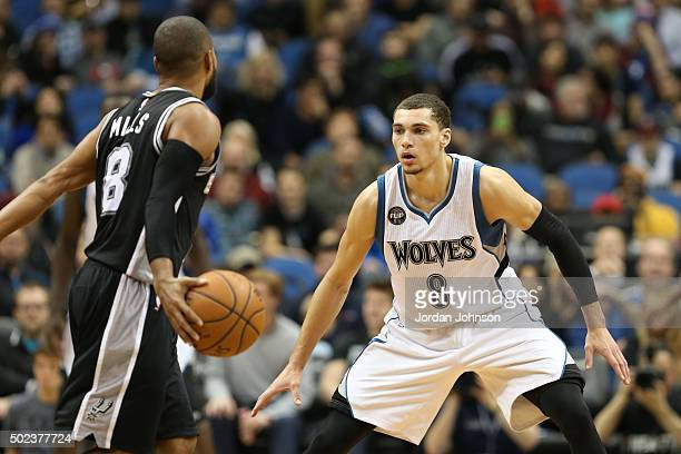 Patty Mills of the San Antonio Spurs defends the ball against Zach LaVine of the Minnesota Timberwolves during the game on December 23 2015 at Target...