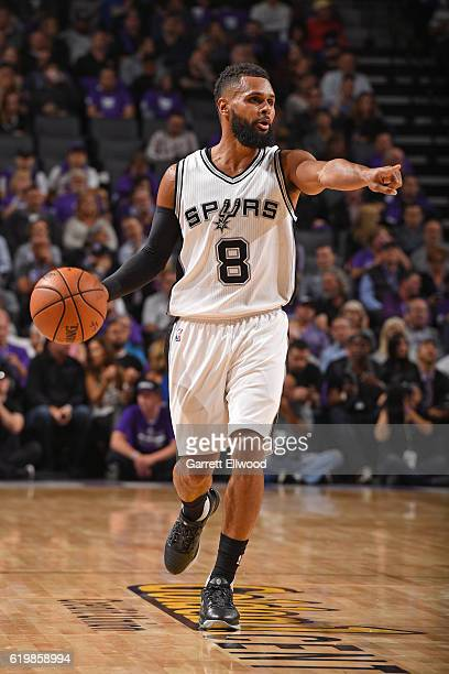 Patty Mills of the San Antonio Spurs dribbles the ball up court and calls a play against the Sacramento Kings on October 27 2016 at the Golden 1...