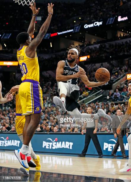 Patty Mills of the San Antonio Spurs drives against Troy Daniels of the Los Angeles Lakers in the second half at ATT Center on November 25 2019 in...