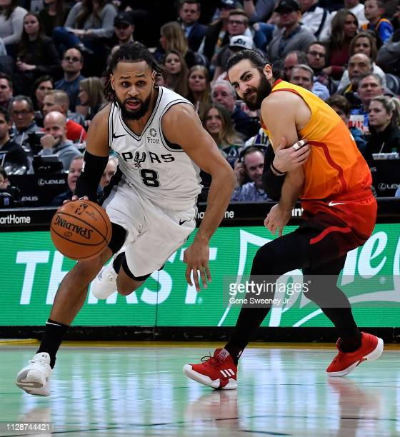 Patty Mills of the San Antonio Spurs drives past Ricky Rubio of the Utah Jazz in a NBA game at Vivint Smart Home Arena on February 09 2019 in Salt...