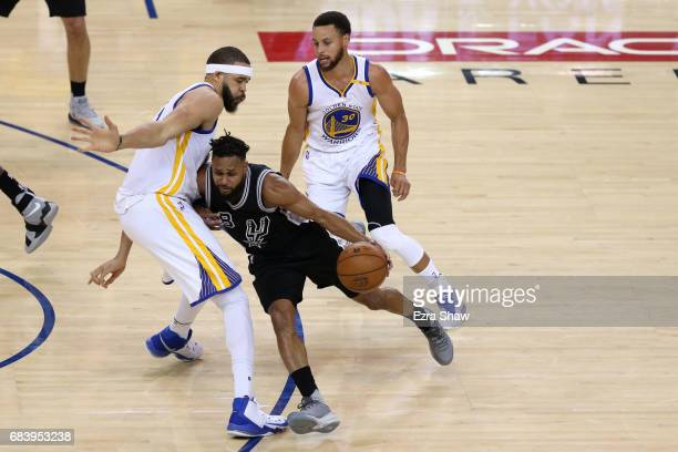 Patty Mills of the San Antonio Spurs drives with the ball against JaVale McGee of the Golden State Warriors during Game Two of the NBA Western...