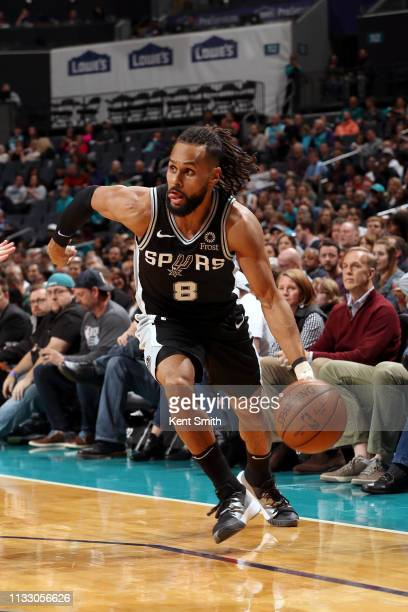 Patty Mills of the San Antonio Spurs handles the ball against the Charlotte Hornets on March 26 2019 at the Spectrum Center in Charlotte North...