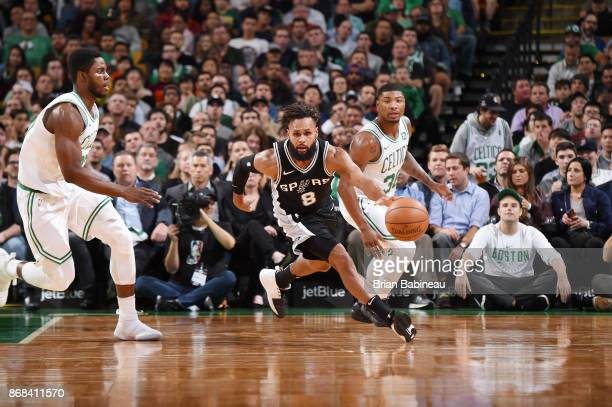 Patty Mills of the San Antonio Spurs handles the ball against the Boston Celtics on October 30 2017 at the TD Garden in Boston Massachusetts NOTE TO...