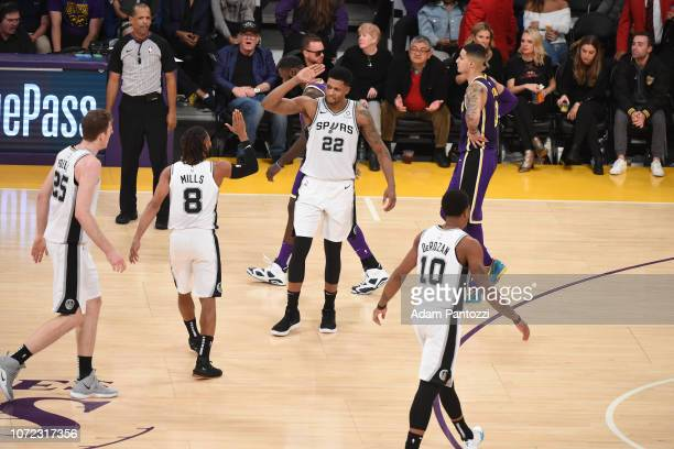 Patty Mills of the San Antonio Spurs highfives Rudy Gay of the San Antonio Spurs against the Los Angeles Lakers on December 5 2018 at STAPLES Center...