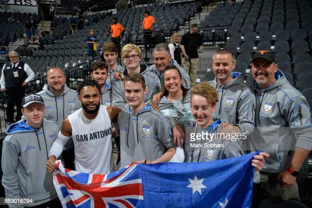 Patty Mills of the San Antonio Spurs poses for a photo with an Australian basketball team before the game qagainst the Memphis Grizzlies on November...