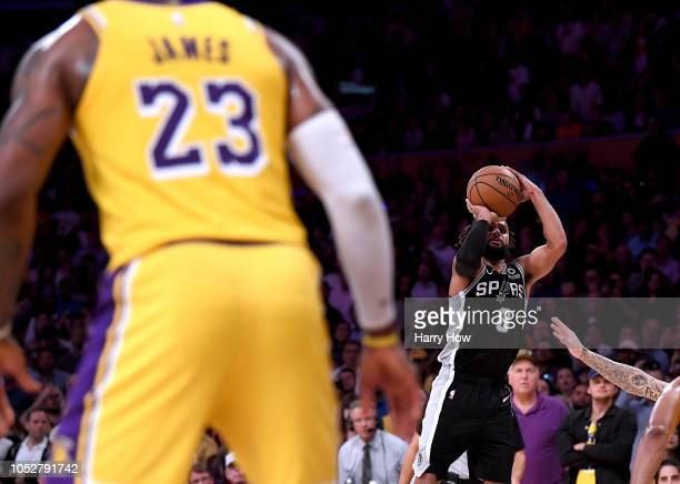 Patty Mills of the San Antonio Spurs scores on his jumper in front of LeBron James of the Los Angeles Lakers to take a 143142 lead during overtime at...