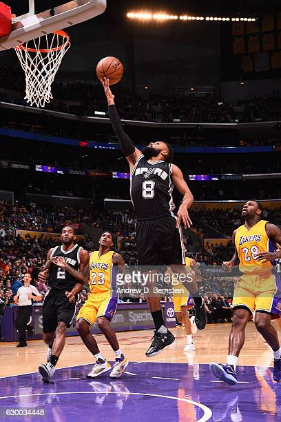 Patty Mills of the San Antonio Spurs shoots a lay up against the Los Angeles Lakers on November 18 2016 at STAPLES Center in Los Angeles California...