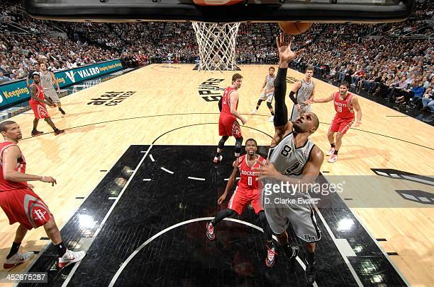 Patty Mills of the San Antonio Spurs shoots against the Houston Rockets at the ATT Center on November 30 2013 in San Antonio Texas NOTE TO USER User...