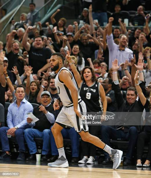 Patty Mills of the San Antonio Spurs' three point shot against the Memphis Grizzlies energizes the fans in Game One of the Western Conference...