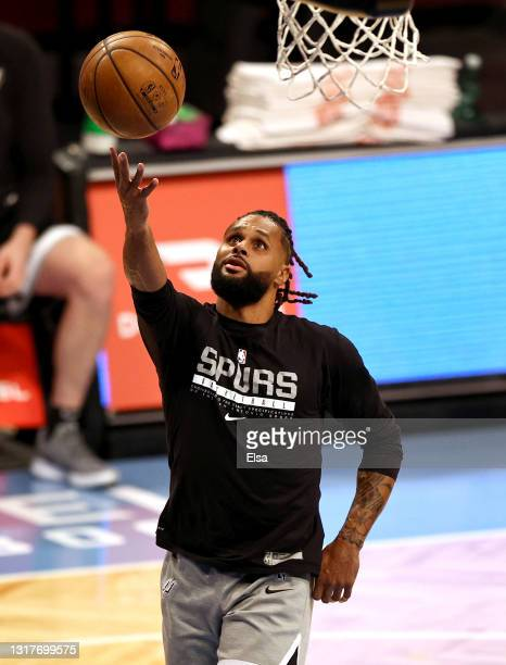 Patty Mills of the San Antonio Spurs warms up before the game against the Brooklyn Nets at Barclays Center on May 12, 2021 in the Brooklyn borough of...
