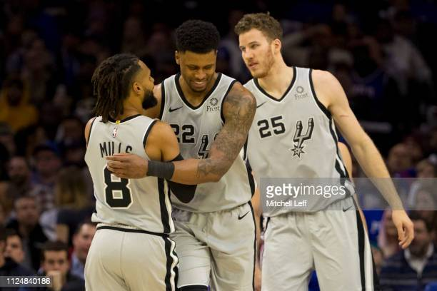 Patty Mills Rudy Gay and Jakob Poeltl of the San Antonio Spurs react against the Philadelphia 76ers at the Wells Fargo Center on January 23 2019 in...