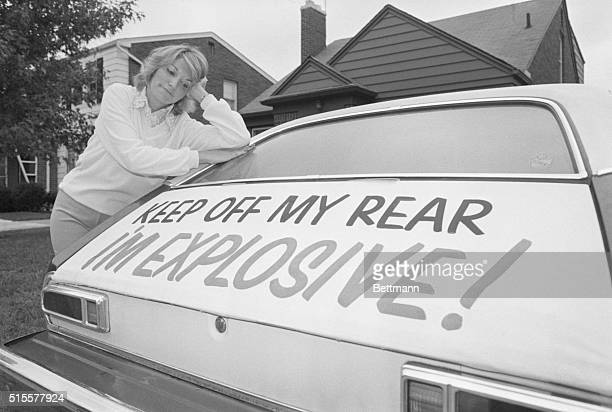 GROSSE POINT FARMS MICH Patty Ramge appears dejected as she looks at her Ford Pinto where she put a sign on the rear of the automobile stating Keep...