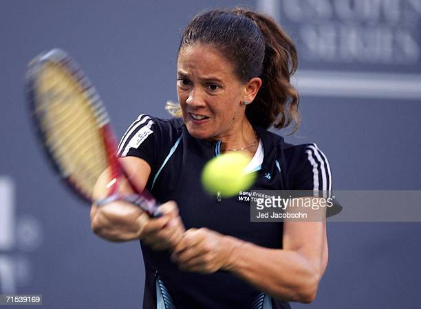 Patty Schnyder of Switzerland returns a shot against Tatiana Golovin of France during the Semifinals of the Bank of the West Classic tennis...