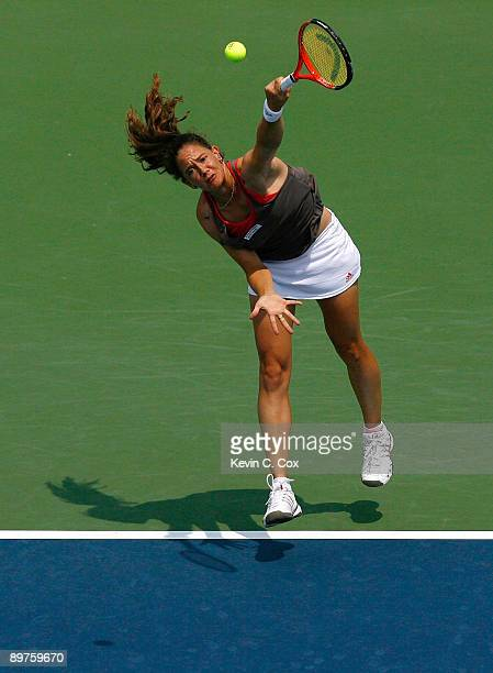 Patty Schnyder of Switzerland serves to Kim Clijsters of Belgium during Day 3 of the Western Southern Financial Group Women's Open on August 12 2009...