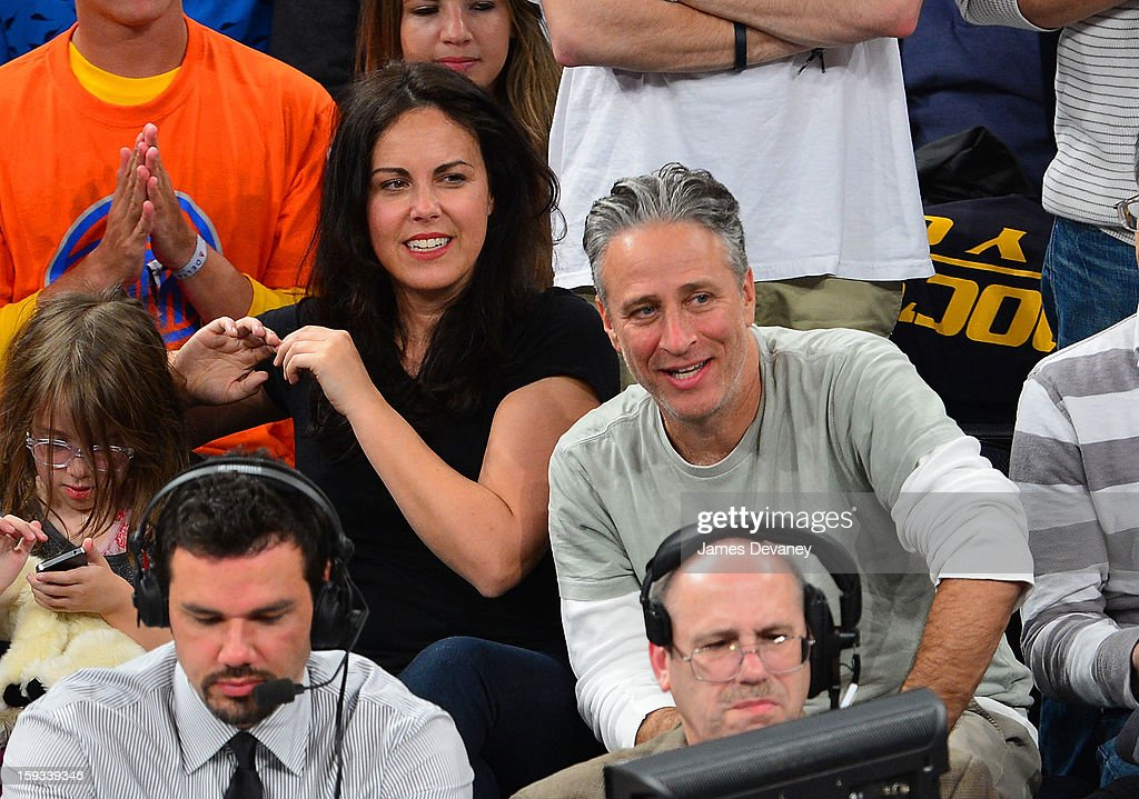 Patty Smyth and Jon Stewart attend the Chicago Bulls vs New York Knicks game at Madison Square Garden on January 11, 2013 in New York City.