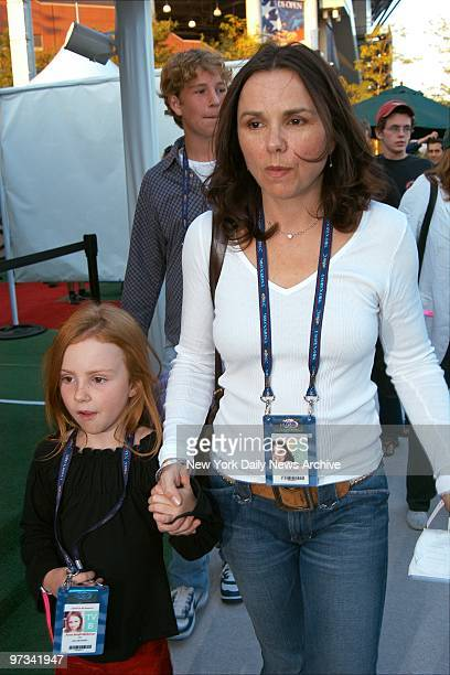 Patty Smyth holds daughter Anna's hand as her son follows along on arrival at the National Tennis Center at Flushing MeadowsCorona Park Queens where...