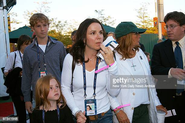 Patty Smyth holds daughter Anna's hand as she and Penny Marshall arrive at the National Tennis Center at Flushing MeadowsCorona Park Queens where the...
