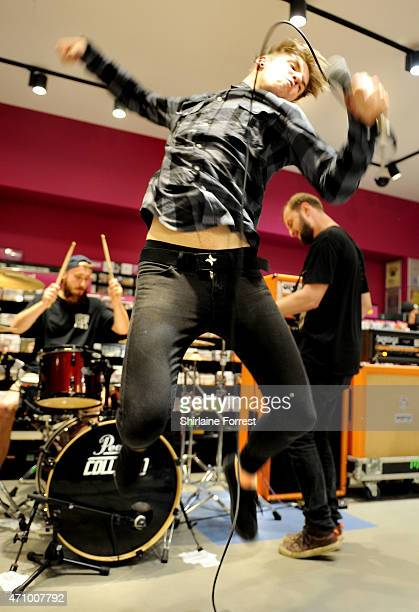 Patty Walters Alistair Testo and Patrick Foley of As It Is perform live and sign copies of their debut album 'Never Happy Ever After' at HMV on April...