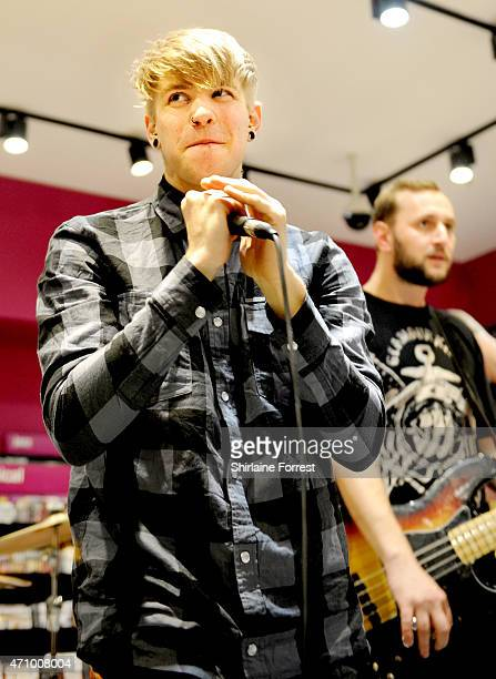 Patty Walters and Alistair Testo of As It Is perform live and sign copies of their debut album 'Never Happy Ever After' at HMV on April 24 2015 in...