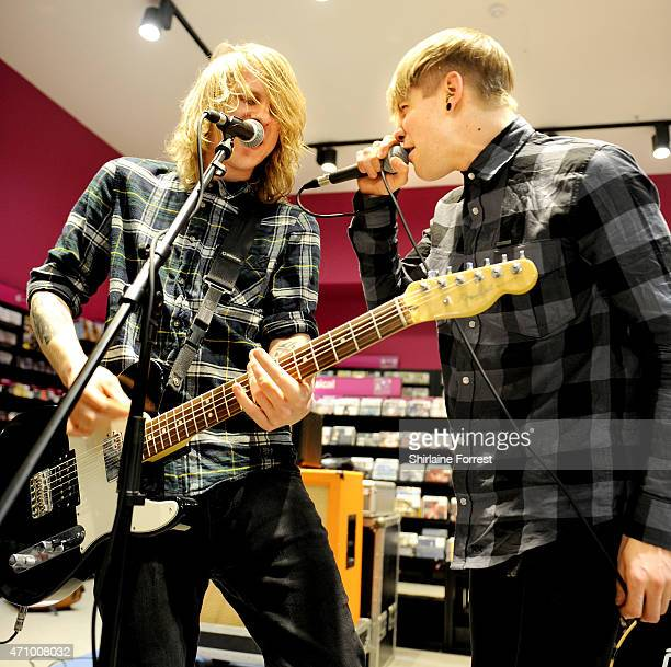 Patty Walters and Ben Biss of As It Is perform live and sign copies of their debut album 'Never Happy Ever After' at HMV on April 24 2015 in...