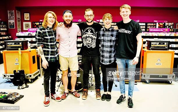 Patty Walters Ben Biss Andy Westhead Alistair Testo and Patrick Foley of As It Is pose after performing live and signing copies of their debut album...