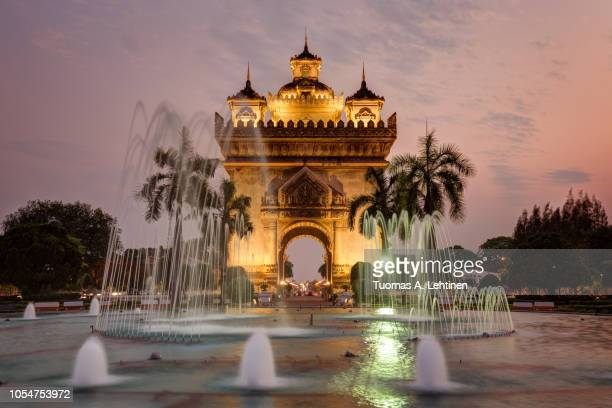 patuxai monument in vientiane at sunset - war memorial stock pictures, royalty-free photos & images