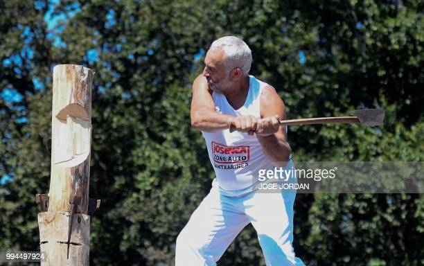 Patxi Larretxea saws a tree trunk with a 'tronza' a traditional Basque saw during a rural Basque sports championship on the third day of the San...