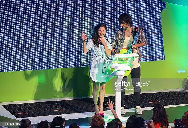 Paty Cantu and MTV VJ Diego Alfaro present the best supporting actress award onstage at the Kids Choice Awards Mexico 2012 at Pepsi Center WTC on...
