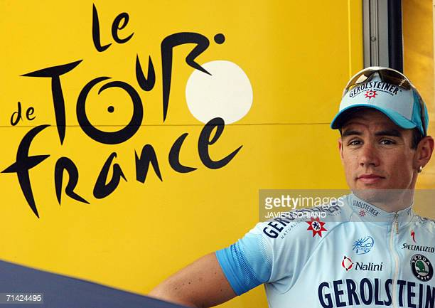 Germany's Markus Fothen celebrates on the podium after he retained the white jersey of best young rider at the end of the 190.5 km tenth stage of the...