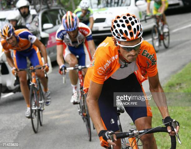 Spain's Iban Mayo rides uphill during the 1905 km tenth stage of the 93rd Tour de France cycling race from CambolesBains to Pau 12 July 2006 AFP...