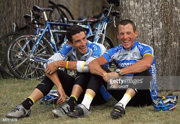 US Lance Armstrong and his teammate US Geogre Hincapie chat before a training session during a rest day in the 92nd Tour de France cycling race in...