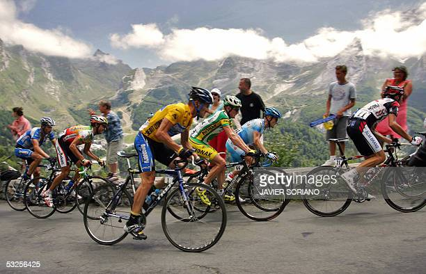 Yellow jersey US Lance Armstrong rides with the pack during the 16th stage of the 92nd Tour de France cycling race between Mourenx and Pau 19 July...